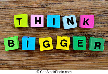 The words Think Bigger on table - The words Think Bigger on...