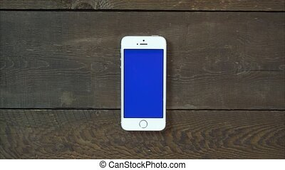 Zoom Out Hand Smartphone with Blue Screen - Female Hand...
