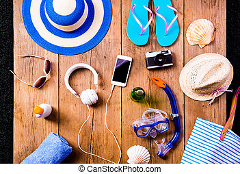 Summer vacation composition. Sandals, hat and other stuff,...