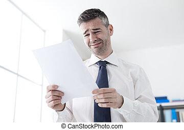 Office worker receiving a dismissal letter