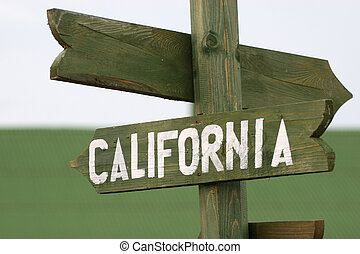 Mile signpost to California - Wooden Mile signpost to...