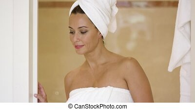 Woman wrapped in towel leaving shower stall - Beautiful...
