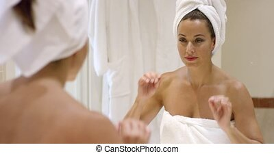 Gorgeous young woman wrapping her hair in a towel - Gorgeous...