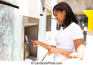 girl at the atm - young woman at the cash machine