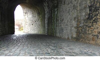 Old abandoned tunnel with light in the end