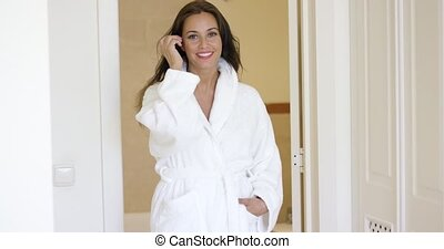 Healthy happy young woman in a spa resort standing indoors...