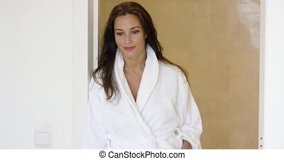 Gorgeous female adult adjusting bath robe - Gorgeous female...