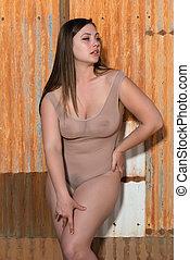 Brunette in a bodysuit - Pretty shapely brunette in a sheer...