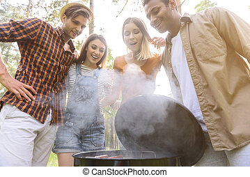 Cheerful men and women want to eat - What appetite barbecue...