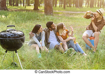 Happy young people relaxing in nature - Joyful man is...