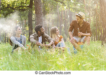 Happy young friends relaxing in nature - Cheerful men and...