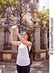 Girl taking a picture above her
