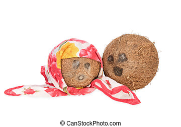 Two coconut as people - One coconut with a handkerchief as a...