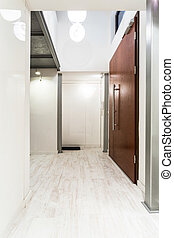 Light home corridor idea - Light entrance hall with brown...