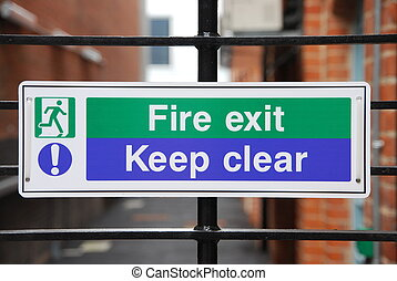 Fire exit sign - fire exit, keep clear sign hanging on a...
