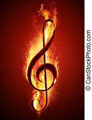 Hot Music - Musical note treble clef from hot charcoal on...