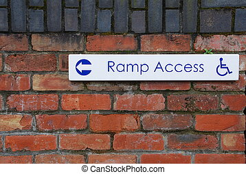 Ramp access sign - ramp access sign on a brick wall...