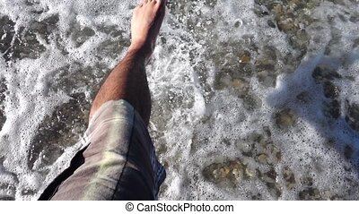 Foots in Seaside and Waves