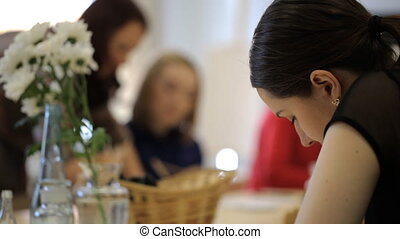 Beautiful young women engaged with artist drawing in group....