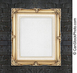 Blank Gold color vintage photo frame hanging on black brick...