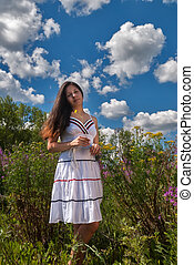 Attractive girl in sundress on meadow - Young beautiful...