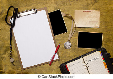 Items for the sports coach on a wooden surface