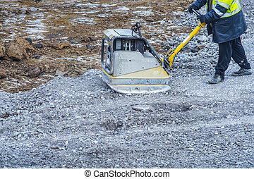 Plate compactor on a construction site - Vibration plate,...