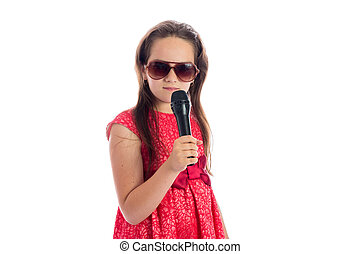 cute little girl with microphone isolated on white...