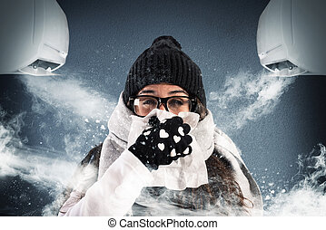 Winter in the summer with the air conditioning - Woman with...