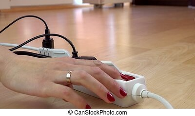 girl hands unplug wires from electricity switch. - girl...
