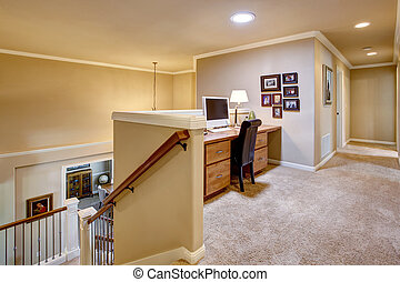 Small home office in the hallway with carpet floor