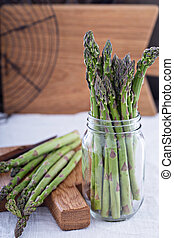 Bunch og fresh green asparagus in a jar - Bunch of fresh...