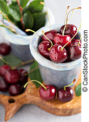 Fresh sweet cherry in a cup