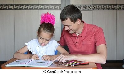 Dad helping homework her daughter grader