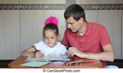The girl first grader and Dad decide logical problems in the...