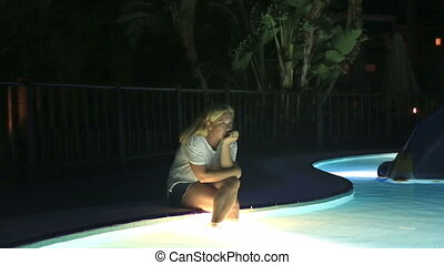 Woman sitting near the pool - Sad woman sitting near the...