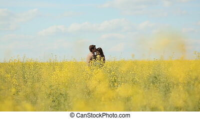 Love couple in a rape field. Shot with a Canon 5D MKIII
