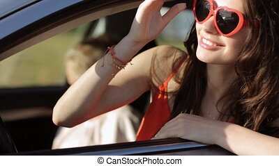 happy teenage girls or women in car at seaside 7 - summer...
