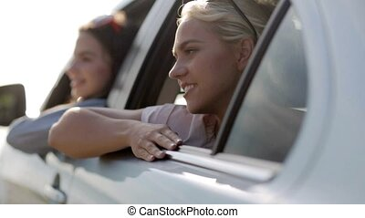 happy teenage girls or women in car at seaside 1 - summer...