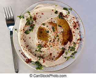 humus - traditional humus dish with olive oil paprika and...