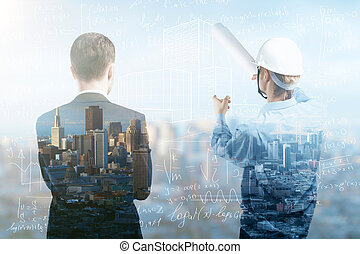 city under construction - engineer and businessman looking...