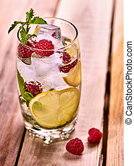 Raspberry mojito with cubes ice glass. - Alcohol drink. On...