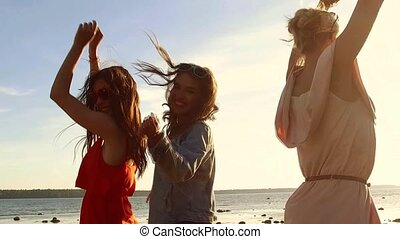 group of happy women or girls dancing on beach 35 - summer...