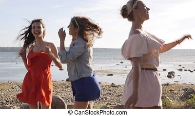 group of smiling women or girls dancing on beach 30 - summer...