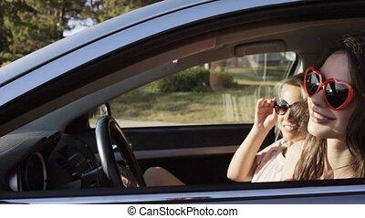 happy teenage girls or women in car at seaside 26 - summer...