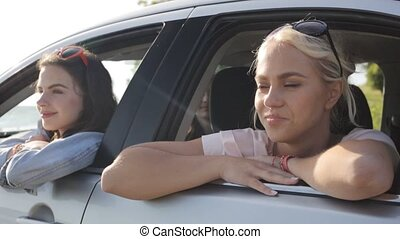 happy teenage girls or women in car at seaside 20 - summer...