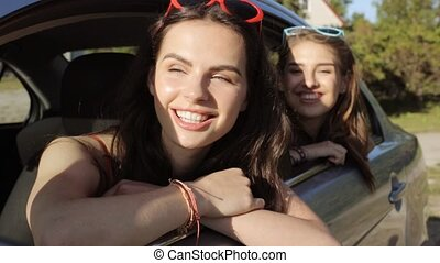happy teenage girls or women in car at seaside 24 - summer...