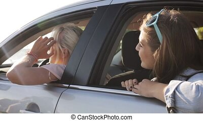 happy teenage girls or women in car at seaside 27 - summer...