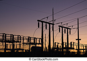 Electric Power Lines at Sunset - Silhouette of electric...