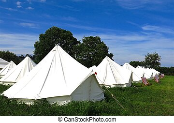 Glamping camping tipis tepees - Tipis tepees in a field on a...